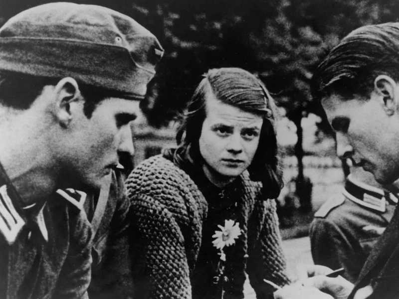 Sophie Scholl and her brother Hans with their friend Christopher in 1942 - AFP photo