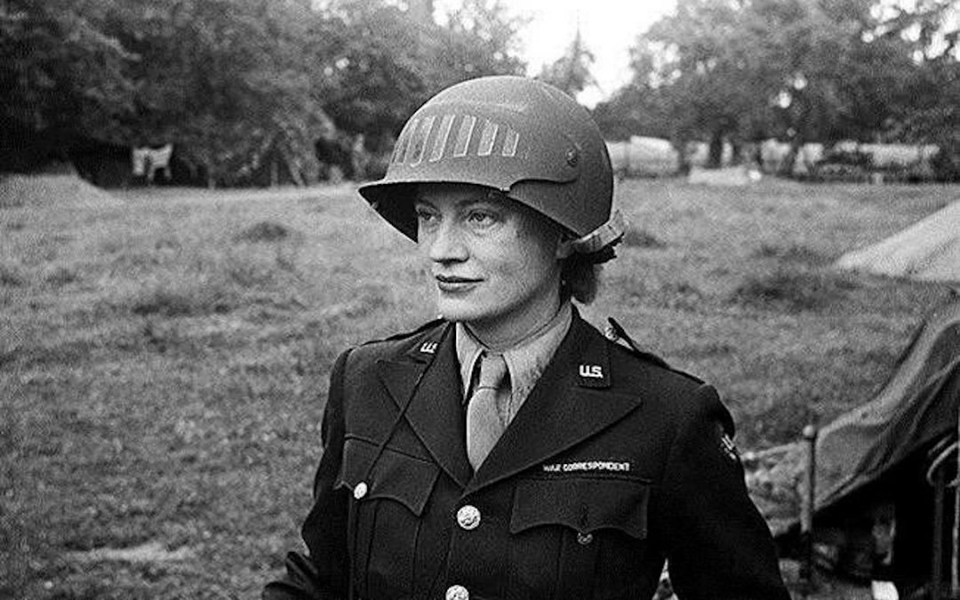 Lee Miller with a steel helmet created especially to use a camera, Normandy, 1944