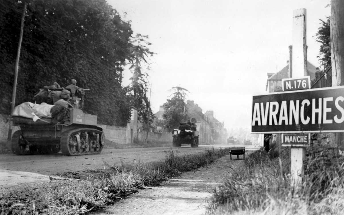 A platoon of light tanks enters Avranches Photo US National Archives